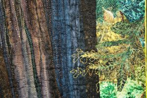"""Here is a detail shot – I use many bright colors of thread to help """"paint"""" the picture."""
